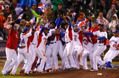 Dominican Republic pitcher Rodney celebrates with teammates after they defeated Puerto Rico to win the World Baseball Classic final in San Francisco